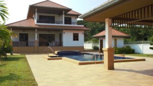 Exterior of luxury Villa Royale F1 with pool in Manora Village, Hua Hin, Thailand
