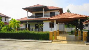 Front exterior of Villa Royale F3 with car port in Manora Village III, Hua Hin, Thailand