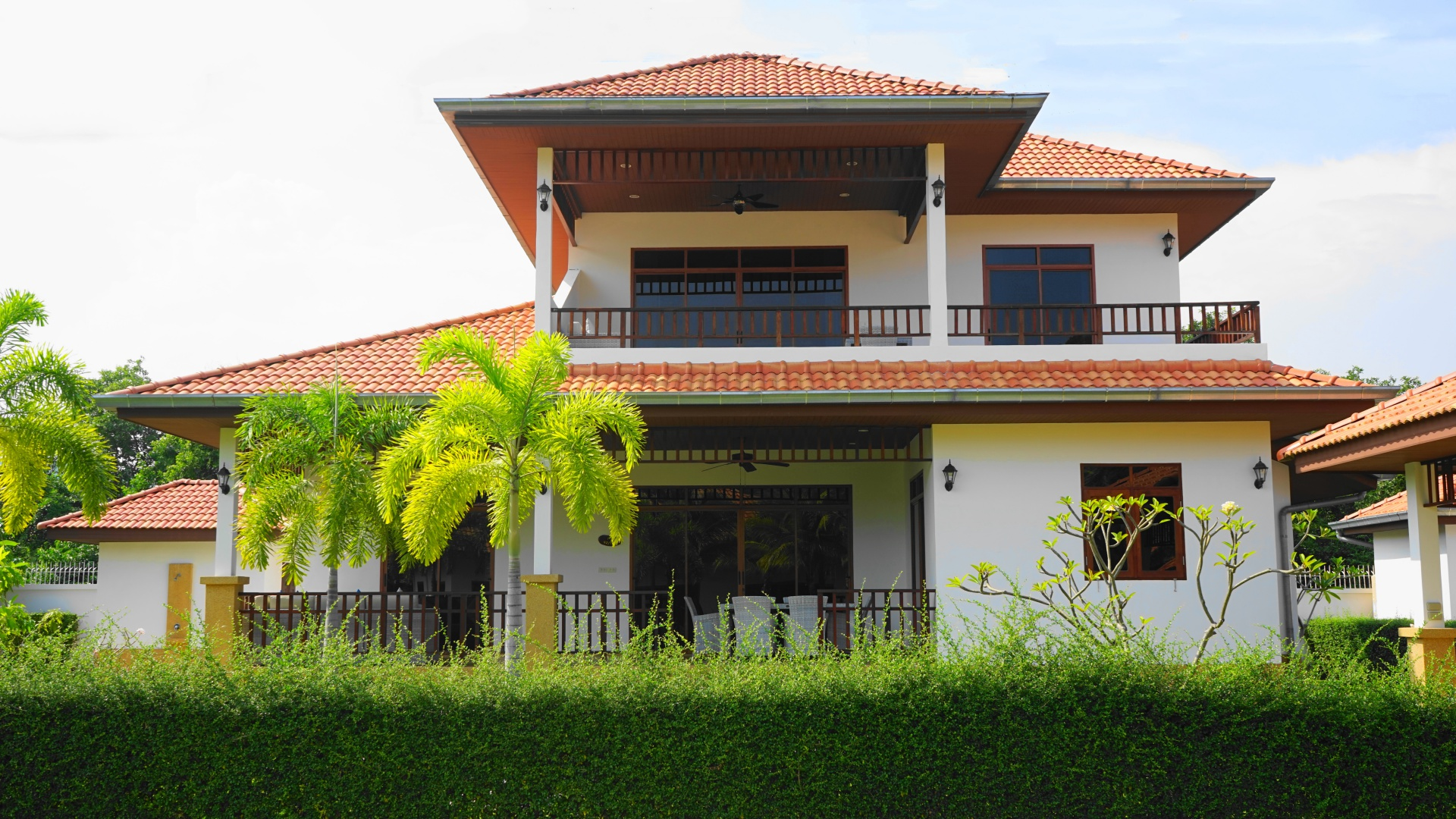 Front exterior of Villa Royale F3 with car port in Manora Village, Hua Hin, Thailand